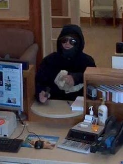 Vermont State Police say the suspect brandished a gun at the Northfield Savings Bank in Waitsfield and fled with an unknown amount of cash on Tuesday.