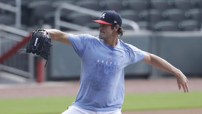 Atlanta Braves pitcher Cole Hamels works out during a practice at Truist Park on Friday in Atlanta.