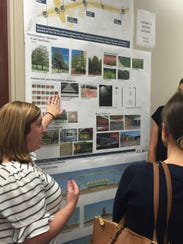 A consultant reviews potential signage and public art