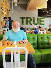 Dr. Andrew Weil, a celebrity holistic health guru, poses for a portrait March 24, 2017 at one of the True Food Kitchen restaurants he helped create.
