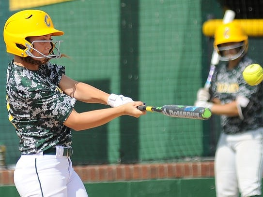 Calvary Marissa Reed turns on a pitch and hits a homer