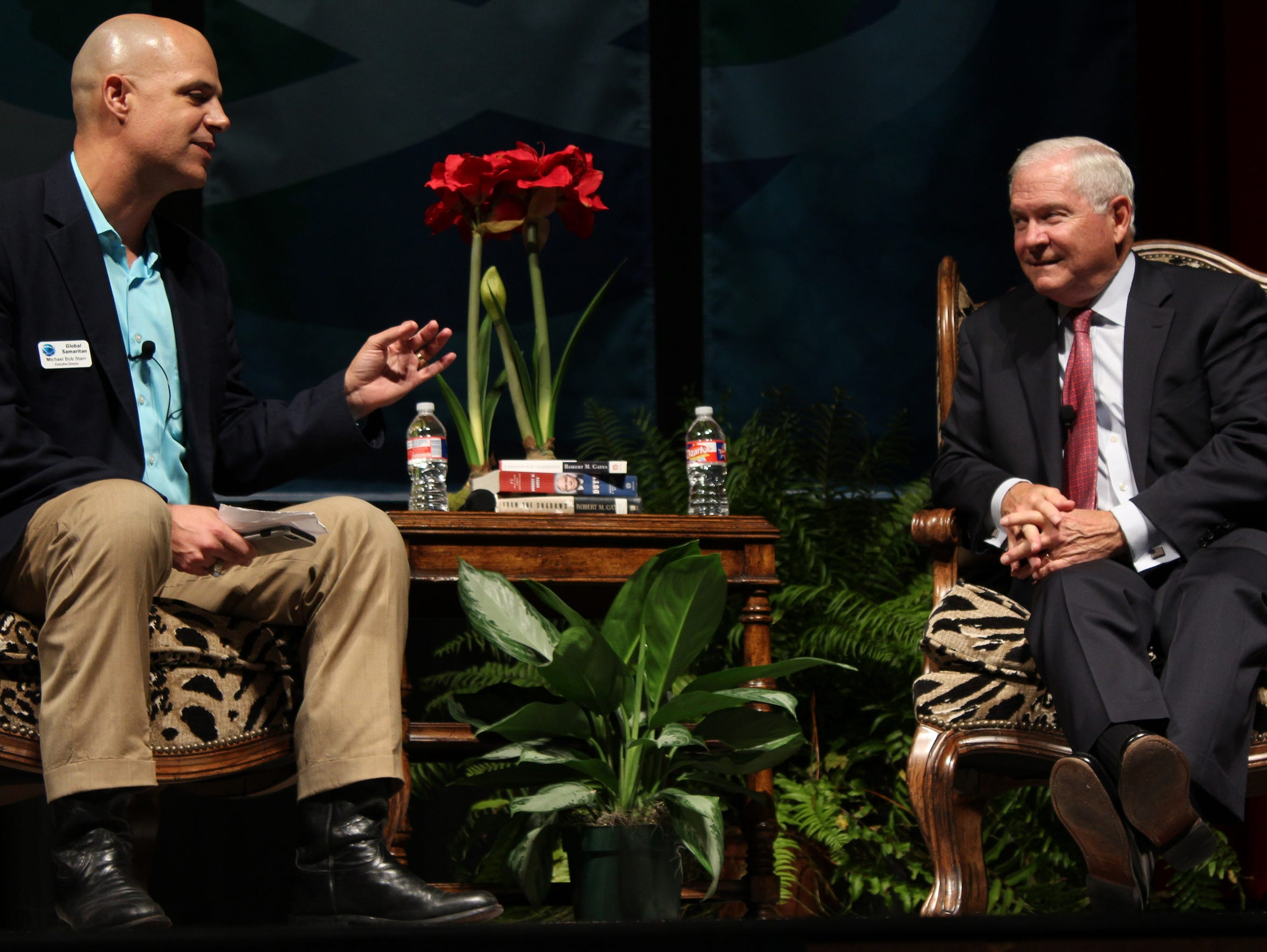 Robert Gates, right, is interviewed by Global Samaritan Resources Executive Director Michael Bob Starr during a fundraiser at the Abilene Convention Center.