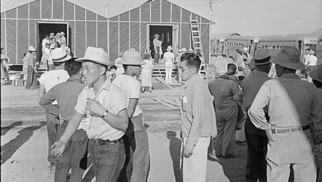 """Japanese-Americans arrive at an internment camp in Poston. The camp was the largest internment center and the third-largest """"city"""" in Arizona during World War II. Poston, Arizona. Site Number 1 Arrival of evacuees of Japanese ancestry at this War Relocation Authority center. 05/26/1942"""