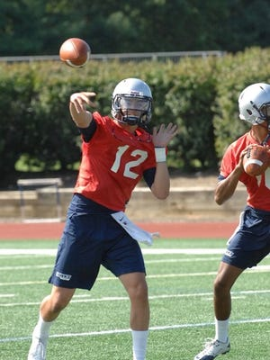 Cody Williams attempts a pass at Monmouth University practice on Tuesday afternoon. The Hawks opened their 24th camp on Tuesday