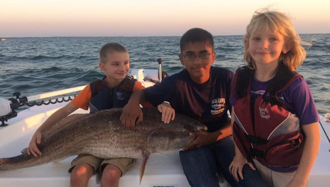 The Abell family scored some nice red drum before the storm.