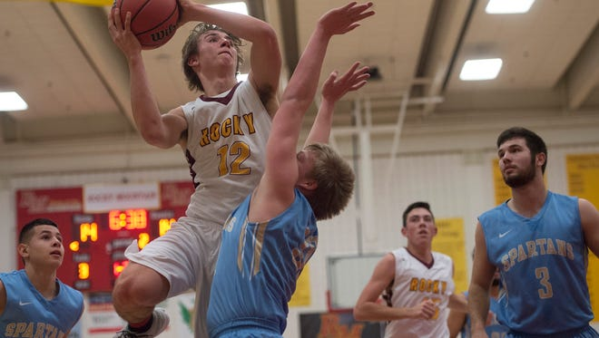 Joseph Urynowicz of Rocky Mountain High School moves in for a layup over Greeley West defense during a game Tuesday, January 10, 2017.