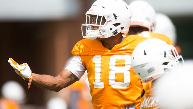 Tennessee defensive back Nigel Warrior (18) stretches during a University of Tennessee fall football practice at Anderson Training Facility in Knoxville, Tenn. on Tuesday, Aug. 15, 2017.