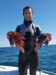 Alex Fogg is a spearfisherman who catches lionfish