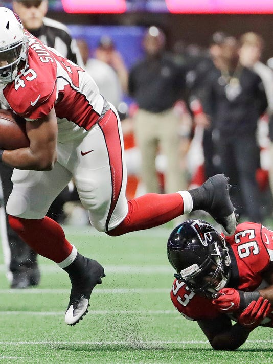Arizona Cardinals running back James Summers (45) is tripped up by Atlanta Falcons defensive end Chris Odom (93) during the second half of an NFL football game, Saturday, Aug. 26, 2017, in Atlanta. (AP Photo/David Goldman)