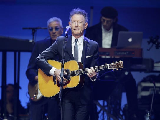 Lyle Lovett performs during a hurricanes relief concert