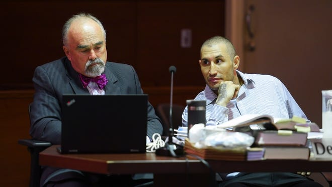 In this Sept. 20 file photo defendant Allan Aloan Agababa, right, glances over to his attorney, Curtis Van de veld, during trial.