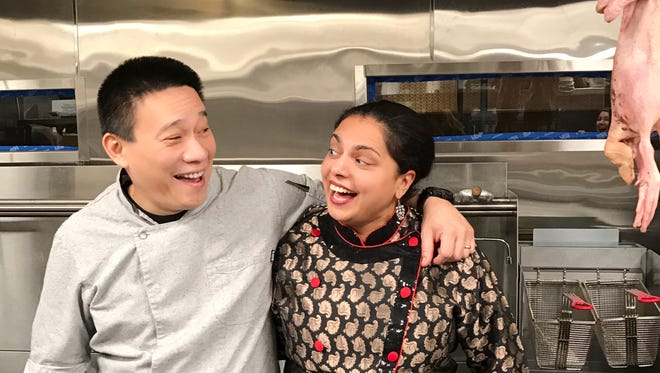 Chefs Chris Cheung and Maneet Chauhan cut up in the kitchen at Tànsuŏ, their new Chinese restaurant that opens March 13, 2017 in the Gulch. In the right foreground, a duck awaits the Peking treatment.
