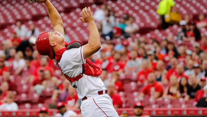 Cincinnati Reds catcher Stuart Turner (32) catches a foul ball during the interleague baseball game between the Baltimore Orioles and the Cincinnati Reds, Thursday, April 20, 2017, at Great American Ball Park in Cincinnati.