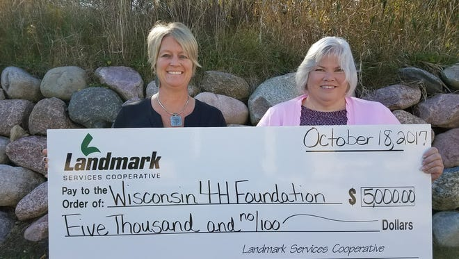 Shannon Horstmeyer, executive assistant for LSC (left) presents $5,000 grant to Brenda Scheider, Wisconsin 4-H Foundation Director for the Wisconsin 4-H Foundation. The funds will support the 4-H Youth Development program.