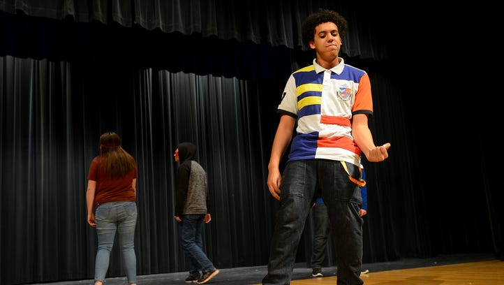 "RaeQuan Ream rehearses his ""Thriller"" dance moves for World Language Night on Tuesday, March 21, 2017 at the auditorium at Waverly High School in Lansing."