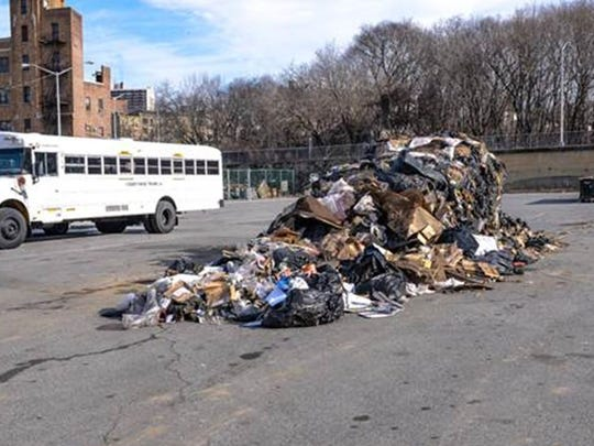 Trash that officials say was illegally dumped is seen in Yonkers' Chicken Island parking lot on Dec. 28, 2014.