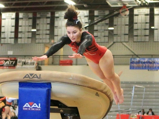 Canton High School gymnast Katherine Najduk, attempting a vault, is among the athletes competing in the 2017 MHSAA gymnastics state championships.