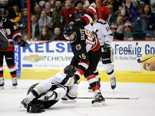 Cyclones left wing Justin Vaive (15) swings around Nailers defender Dan Milan (6) as they fight in the first period of the EHL hockey game between the Cincinnati Cyclones and the Wheeling Nailers at US Bank Arena in downtown Cincinnati on Saturday, Jan. 6, 2018.