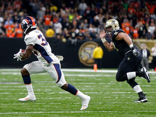 Denver Broncos defensive back Will Parks (34) grabs a blocked extra point and returns it for a safety as New Orleans Saints center Max Unger (60) pursues in the second half of an NFL football game in New Orleans, Sunday, Nov. 13, 2016. The Broncos won 25-23. (AP Photo/John McCusker)