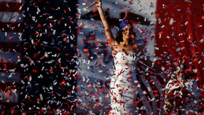 Katy Perry sings during a rally for Democratic Presidential candidate Hillary Clinton before the historic Iowa Democratic Party's annual Jefferson-Jackson Dinner in Downtown Des Moines on Saturday, October 24, 2015.