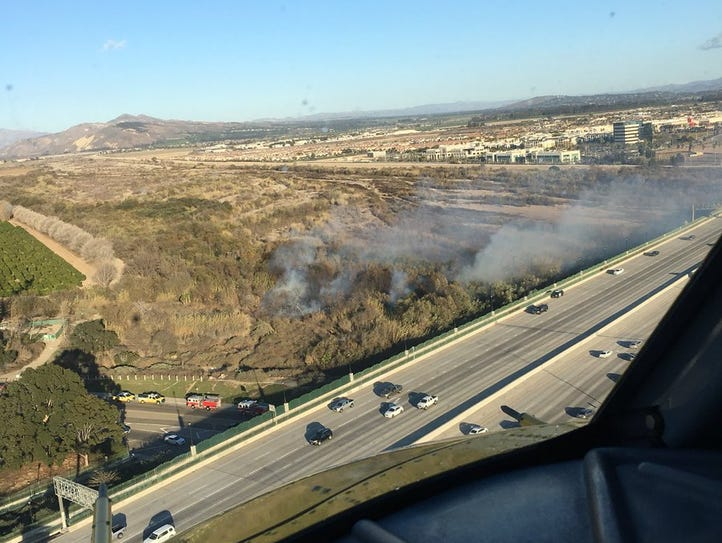 Copter 6 on scene of a 1 acre brush fire in the bottom,