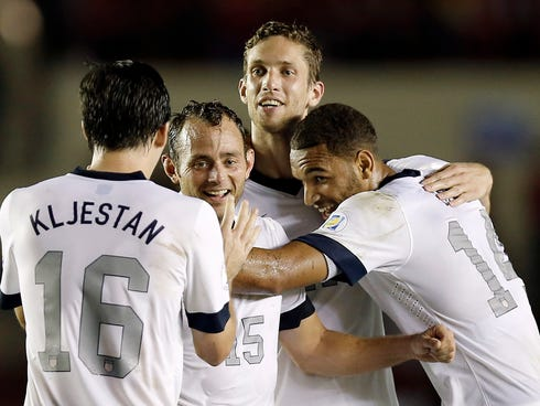 Oct 15, 2013; Panama City, Panama; United States players from left Sacha Kljestan , Brad Davis , Clarence Goodson and Terrance Boyd celebrate the game-winning goal by Aron Johannsson during the second half of their 3-2 win over Panama in a World Cup