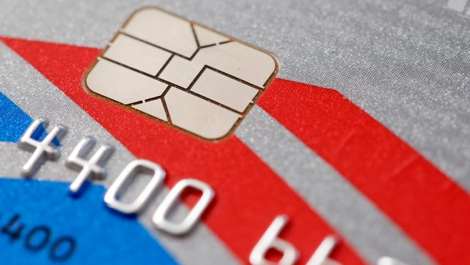 Some major merchants see fraud decline as they process new chip-enabled cards, Visa says.