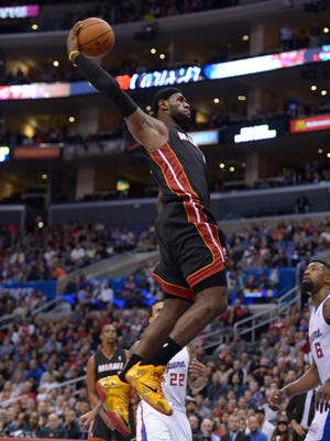 LeBron James dunks home two of his team-high 31 points.