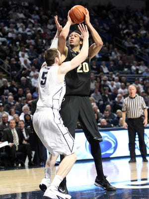 Jan 17, 2015; University Park, PA, USA; Purdue Boilermakers center A.J. Hammons (20) shoots the ball as Penn State Nittany Lions forward Donovon Jack (5) guards during overtime at Bryce Jordan Center. Purdue defeated Penn State 84-77 in overtime. Mandatory Credit: Matthew O'Haren-USA TODAY Sports