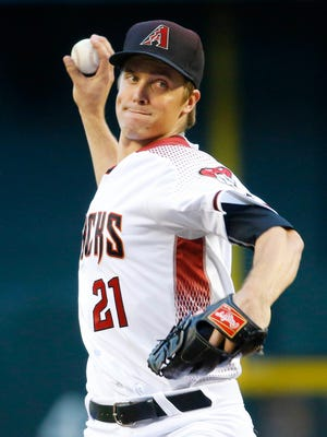 Arizona Diamondbacks starting pitcher Zack Greinke (21) throws against the Los Angeles Dodgers during the first inning of their MLB game Monday, June 13, 2016 in Phoenix,  Ariz.