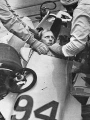 Safety personnel attend to Bill Whittington after a