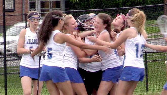 Millbrook celebrates after defeating James O'Neill 16-4 in the Section 9 Class D girls lacrosse championship at the Newburgh Free Academy May 23, 2017.