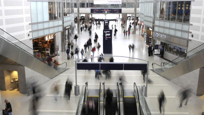 Passengers make their way through the McNamara Terminal at Detroit Metro Airport.