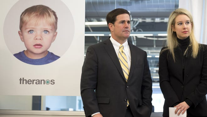 Arizona Gov. Doug Ducey with Theranos founder Elizabeth Holmes at a bill-signing ceremony in 2015.