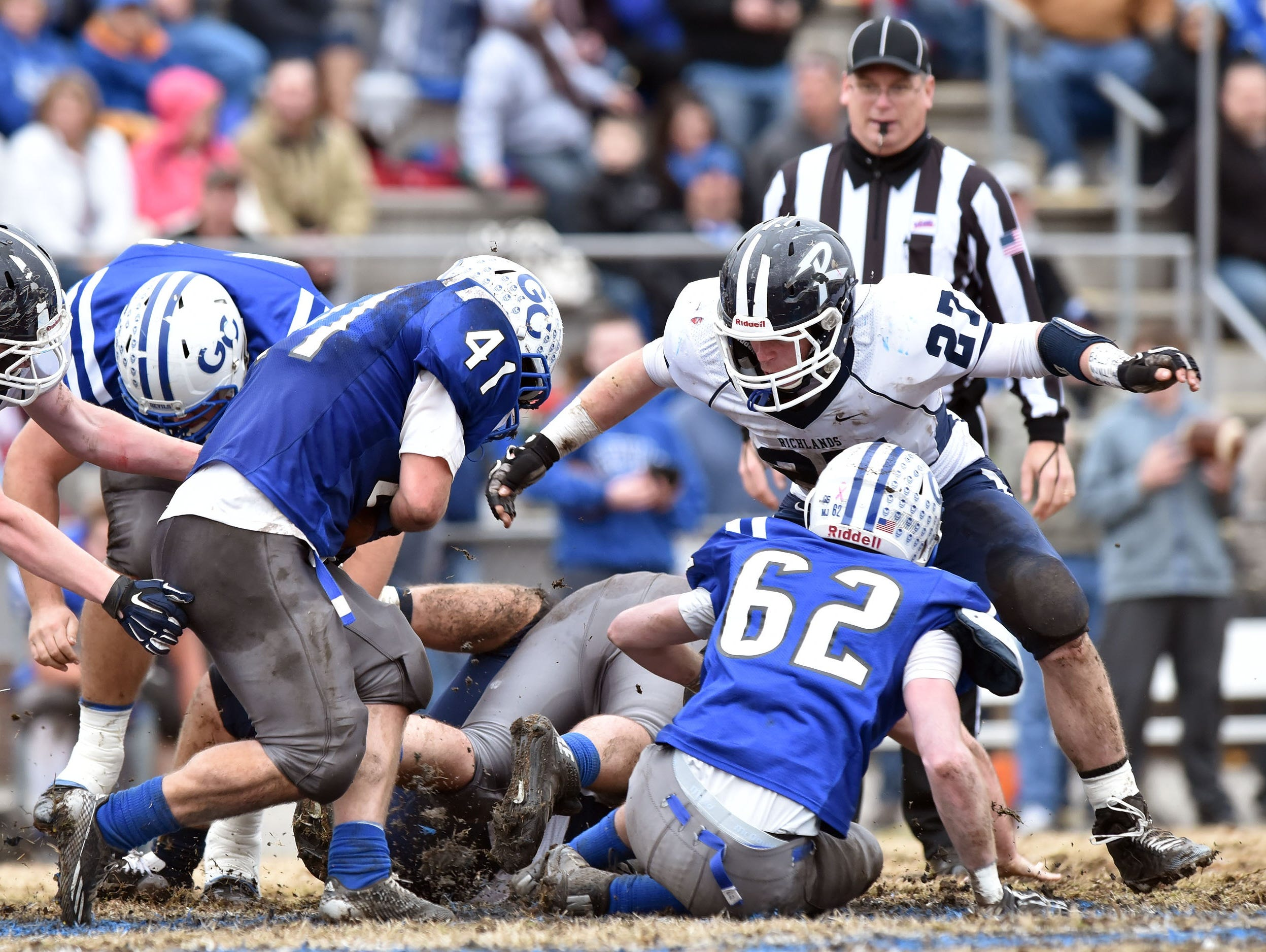 Richlands' Bryce Wade (27) moves in to help make a stop on Gate City's Evan Baker during Saturday's Group 2A quarterfinal game.