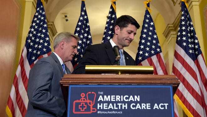 House Speaker Paul Ryan of Wis., right, takes his notes as he and House Majority Whip Kevin McCarthy, R-Calif., walk away following a news conference on the American Health Care Act on Capitol Hill in Washington, Tuesday, March 7, 2017.