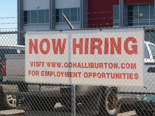 In this file photo, a Halliburton facility in Odessa posts an employment sign. In an annual study of the labor force, Wichita Falls fell to 44th  place (62.7 percent) for percentage of people working or looking for work in the city.