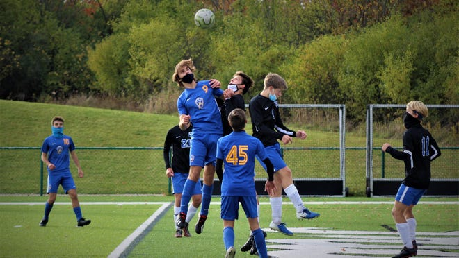Ida's Evan Schmitz (9) goes up to challenge the ball against Jefferson's Jac White and Connor Scroi on Tuesday in the Division 3 District semifinals at Ann Arbor Gabriel Richard. Ida won 4-0.