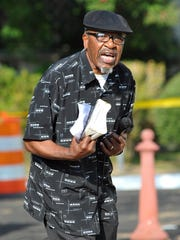 John Perkins speaks outside Jackson City Hall before the Feet to Faith Prayer Walk.