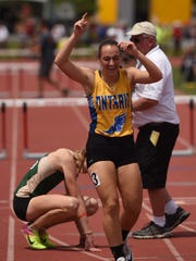 Ontario's Rachel Miller celebrates winning the 300 hurdles during the Division II state track meet at Jesse Owens Memorial Stadium Saturday.