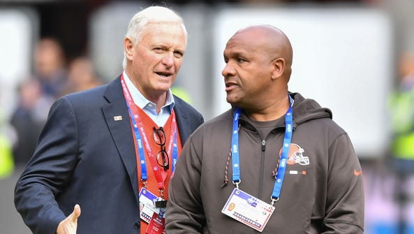 Browns owner Jimmy Haslam, left, still hopes coach