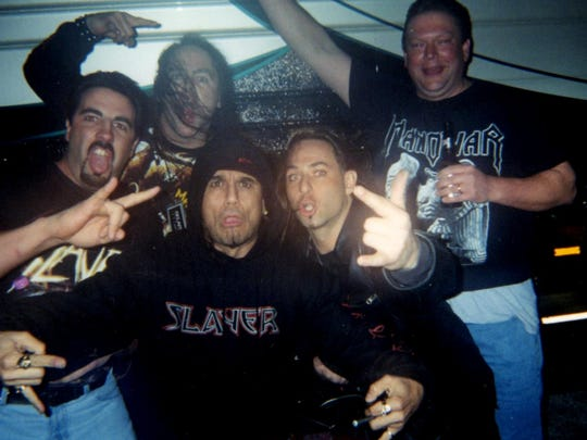 Brad Lindsay, left to right, Max Mayer, Tom Araya of Slayer, Todd Tousey and Kurt Fahler pose for a photo at the Eagles Ballroom in Milwaukee.