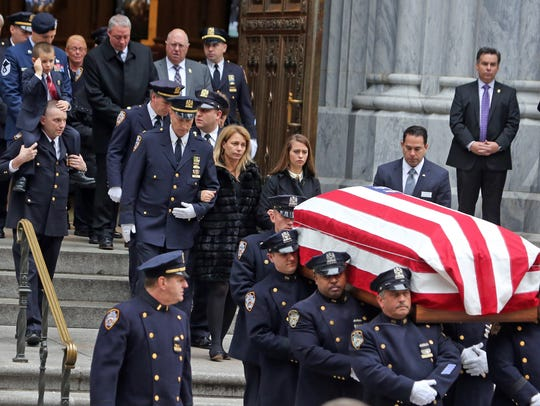 The family of Joseph Lemm follows his casket from St.