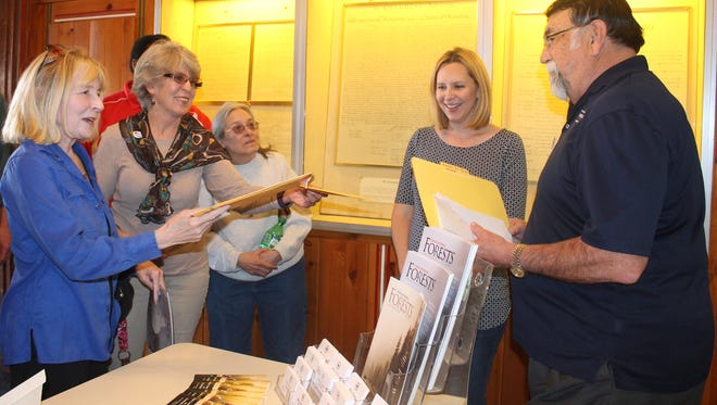 Local residents deliver letters addressing their concerns with the Trump administration to Joe Martinez, a field representative for Congressman Steve Pearce's office, on Tuesday afternoon.