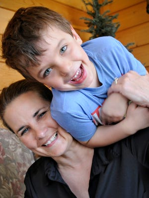 Heidi Everett plays with her son Boothe, 5, on April 15 at their St. Joseph-area home. Everett was pregnant with her son when the Creative Memories lawsuit started. He is now in kindergarten.