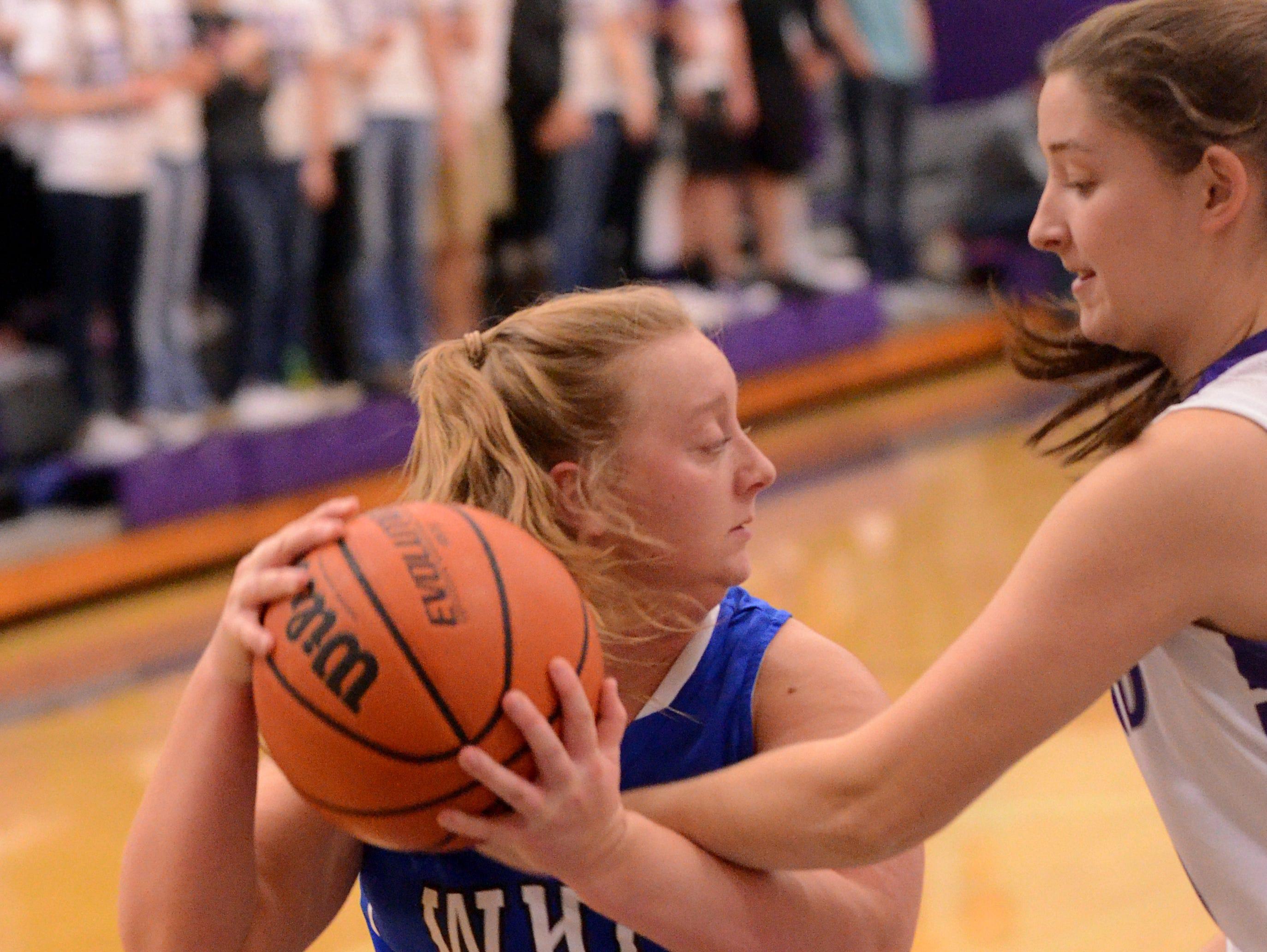 White House High senior guard Lauren Felts (3) is pressured by Portland sophomore Taylor Cole. Felts scored six points.