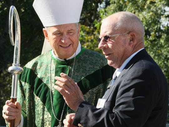 A special 30th Anniversary Mass of the Papal Visit was held at Saint Patrick's Irish Settlement south of Cumming in 2009. After the Mass, Bishop Richard Pates visits with Joe Hays, who wrote the original letter inviting the pope to come for a visit. He was 39 at the time.