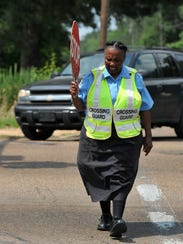 Crossing guard Charlotte Williams works the intersection