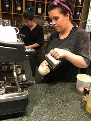Maya Gaughn pours a latte at Hastings Tea & Coffee in White Plains. May 16, 2018