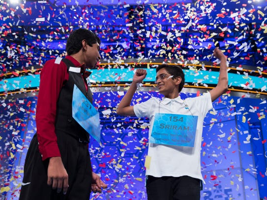 Ansun Sujoe, 13, of Fort Worth, Texas, left, and Sriram Hathwar, 14, of Painted Post, N.Y., celebrate after being named co-champions of the National Spelling Bee, on Thursday, May 29, 2014, in Oxon Hill, Md. (AP Photo/Evan Vucci)